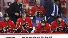 Calgary Flames players watch from the bench as the Anaheim Ducks celebrate their overtime victory in Game 3 in Calgary on Monday, April 17, 2017. (Larry MacDougal/THE CANADIAN PRESS)