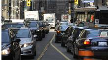 Morning traffic on Bay St. near Front St. West in downtown Toronto. (2012 file photo) (Fred Lum/The Globe and Mail)