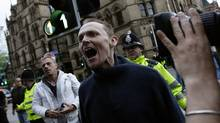 A man protests against the British National Party before the European election results are announced at the Town Hall in Manchester, northern England June 7, 2009. (Darren Staples, Reuters)