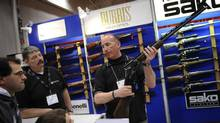 Gun enthusiasts at the Toronto Sportsmen's Show at the Direct Energy Centre in at Exhibition Place in Toronto in 2009. (The Globe and Mail)