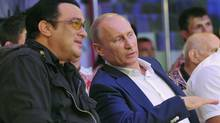 This is a Saturday, Aug. 11, 2012, file photo Russian President Vladimir Putin, and U.S. actor Steven Seagal, left, as they watch the first Russian national championship of mixed martial arts in the Black Sea resort of Sochi, southern Russia. (Alexei Nikolsky/ASSOCIATED PRESS)