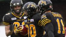 Hamilton Tiger Cats Chris Williams celebrates scoring a touch down against Winnipeg (Chris Young/The Canadian Press)