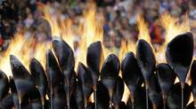 The Olympic flame burns in the Olympic Stadium at the 2012 Summer Olympics, London, Monday. (Matt Slocum/AP)