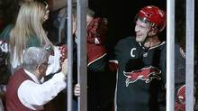 Phoenix Coyotes' Shane Doan, who got his 500th career assist, smiles as he gets high-fives from the crowd after an NHL hockey game against the Los Angeles Kings, Tuesday, Jan. 28, 2014, in Glendale, Ariz. (Associated Press)