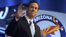 U.S. Republican presidential candidate Rick Santorum waves before the start of the presidential candidates debate in Mesa, Ariz., on Feb. 22, 2012. (Laura Segall/Reuters/Laura Segall/Reuters)