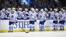 Toronto Maple Leafs players celebrate after a goal against the St. Louis Blues in St. Louis on Dec. 5, 2015. The combined ratings for the Leafs on all the Rogers-connected networks that carry them, CBC, Sportsnet and City, are down 30 per cent from Oct. 7 through Nov. 21. (Tom Gannam/THE CANADIAN PRESS/AP)