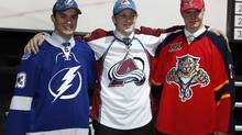 The top three picks in the 2013 National Hockey League (NHL) draft pose together at the draft in Newark, New Jersey, June 30, 2013. At center is top pick Nathan MacKinnon of the Colorado Avalanche, at left is Jonathan Drouin the third overall pick by the Tampa Bay Lightning and at right is Aleksander Barkov the second overall pick taken by the Florida Panthers. (Brendan McDermid/Reuters)
