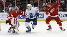 Detroit Red Wings goalie Petr Mrazek (34), of the Czech Republic, and teammate Alexey Marchenko (47), of Russia, try to stop Toronto Maple Leafs' Zach Hyman (11) from advancing on the puck during the first period of an NHL hockey game Sunday, March 13, 2016, in Detroit. (Duane Burleson/AP)