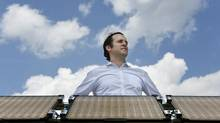 John Paul Morgan, president and chief technology officer of Morgan Solar, beside an array of panels at the company's Toronto facility. (Fred Lum/The Globe and Mail)