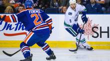The NHL suspended Edmonton Oilers defenceman Andrew Ference (21) for three games Monday for an illegal check to the head of the Vancouver Canucks' Zack Kassian (9). (Sergei Belski/USA TODAY Sports)