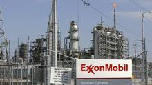 To be sure, oil shares are down, but by far less than those of the rock variety. In half a year, Exxon Mobil has lost a mere 8 per cent. (Jessica Rinaldi/Reuters)