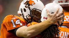 B.C. Lions' quarterback Travis Lulay, left, and Jamal Robertson celebrate Robertson's touchdown against the Edmonton Eskimos during first half CFL football game action in Vancouver, B.C., on Saturday October 29, 2011. THE CANADIAN PRESS/Darryl Dyck (Darryl Dyck/CP)