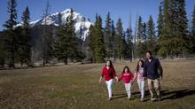 Hernan Argana and his wife Lady Ann are photographed with their two daughters: Hershey Anne, age 7 and Hershey Ynan age 11 near their home in Banff, Alberta on Tuesday, April 29, 2014. (Chris Bolin For The Globe and Mail)