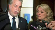 Quebec Premier Philippe Couillard speaks at the legislature in Quebec City on June 11, 2014, as Public Security Minister Lise Thériault looks on. (JACQUES BOISSINOT/THE CANADIAN PRESS)