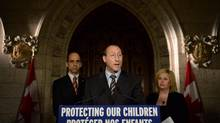 Peter MacKay, Minister of Justice and Attorney General of Canada speaks as Steven Blaney, Minister of Public Safety and Emergency Preparedness, back right, Lianna McDonald, Executive Director of the Canadian Centre for Child Protection, join him in making an announcement on Parliament Hill in Ottawa on Wednesday, Nov. 20, 2013., as part of Bullying Awareness Week. THE CANADIAN PRESS/Sean Kilpatrick (Sean kilpatrick/THE CANADIAN PRESS)