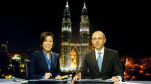 News anchors Veronica Pedrosa and Teymoor Nabili at the Al Jazeera broadcast centre in Kuala Lumpur, Malaysia. (AFP/Getty Images)