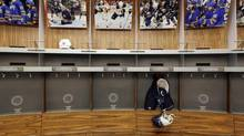 An empty locker room is shown during the NHL labour lockout at the First Niagara Center, home of the Buffalo Sabres hockey team, in Buffalo, N.Y., Sept.25, 2012. (David Duprey/AP)