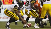 Hamilton Tiger-Cats quarterback Henry Burris fumbles the football during the first half of their CFL football game against the BC Lions in Vancouver, British Columbia July 6, 2012. (Reuters)