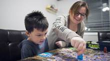 Valerie Anne Fontaine, with six-year-old son Aaden, was taken aback at the cost of child care when her family moved to Delta, B.C., from Gatineau, Que., where the province subsidizes daycare. (Rafal Gerszak/the globe and mail)