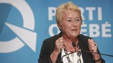 "Quebec Premier Pauline Marois gestures as she speaks at the ""Universite d'ete des jeunes du Parti Quebecois"" event in Quebec City, Sunday, August 25, 2013. (FRANCIS VACHON/THE CANADIAN PRESS)"
