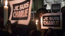 People gather outside the French Consulate in Toronto on Wednesday January 7, 2015 in response to the shootings earlier in the day at Charlie Hebdo Magazine in Paris. THE CANADIAN PRESS/Chris Young (Chris Young/THE CANADIAN PRESS)