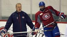 Montreal Canadiens defenceman P.K. Subban takes part in his first full practice with the team since signing a two year contract as head coach Michel Therrien looks on Friday, February 1, 2013 in Brossard, Que. (Ryan Remiorz/THE CANADIAN PRESS)