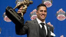 Toronto Argonauts receiver Chad Owens poses with the trophy for Most Outstanding Player during the CFL awards show in Toronto Thursday, November 22, 2012. Toronto Argonauts General Manager Jim Barker is not happy with a decision by Owens to participate in an upcoming MMA event. (Sean Kilpatrick/THE CANADIAN PRESS)