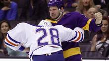 Los Angeles Kings left wing Kyle Clifford, right, scuffles with Edmonton Oilers left wing Ryan Jones (28) during the second period of an NHL hockey game Sunday, Oct. 27, 2013, in Los Angeles. (ALEX GALLARDO/AP)