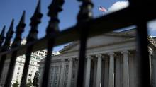 The U.S. Treasury building in Washington, D.C. Federal Reserve chief Ben Bernanke last week sketched a gloomy picture of a stumbling U.S. recovery that will keep interest rates at rock-bottom levels well into 2014 (Brendan Smialowski/Bloomberg/Brendan Smialowski/Bloomberg)