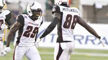 Ottawa RedBlacks' Chevon Walker (29) and Carlton Mitchell (88) celebrate a touchdown against the Edmonton Eskimos during first half action in Edmonton, Alta., on Friday July 11, 2014. (JASON FRANSON/THE CANADIAN PRESS)