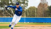 Toronto Blue Jays pitcher J.P. Howell takes part in a drill during baseball spring training in Dunedin, Fla., on Wednesday, February 15, 2017. THE CANADIAN PRESS/Nathan Denette