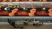 People shop down the aisles of a recently opened supermarket in Mumbai on Dec. 1, 2011. In most of the country, India's 1.2 billion consumers endure high prices, shoddy goods and rotten vegetables. (VIVEK PRAKASH/VIVEK PRAKASH/REUTERS)