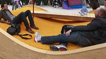 People relax and children play during the lunch hour at the Picnurbia installation in Robson Square in Vancouver, B.C. August 10, 2011. (Jeff Vinnick/The Globe and Mail/Jeff Vinnick/The Globe and Mail)
