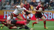 Wales' Chris Knight, right, runs for the winning try as Canada's Harry Jones, left, stretches but fails to reach him during the HSBC World Rugby Sevens Series' Canada sevens tournament action, in Vancouver, B.C., on Saturday March 12, 2016. (DARRYL DYCK/THE CANADIAN PRESS)