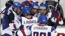 Slovakia's team players celebrate a goal