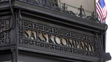 An ironwork logo adorns the facade of Saks flagship store on New York's Fifth Avenue. (RICHARD DREW/AP)