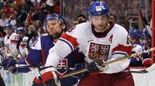 Jaromir Jagr of Czech Republic elbows his way past Richard Zednik of Slovakia at Canada Hockey Place during the Vancouver 2010 Winter Olympics. (Bruce Bennett/Getty Images)