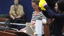 Jessica Lauren Annis, left, founder of Operation Pushback and her daughter Mikaila Bickford, speak out against the single-use bag ban that is set to be enacted by Toronto City Council. (Fred Lum/The Globe and Mail)