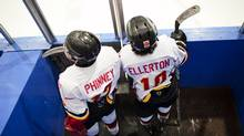 Two members of the Leaside Flames Bantam AA team sit in the penalty box during a GTHL hockey game at St. Michael's arena. (Della Rollins for The Globe and Mail/Della Rollins for The Globe and Mail)