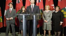 Ontario Premier Dalton McGuinty speaks in front of new cabinet ministers Eric Hoskins, Sophie Aggelonitis, Linda Jeffrey and Carol Mitchell after their swearing in ceremony at Queen's Park on Monday January 18, 2010. (FRANK GUNN)
