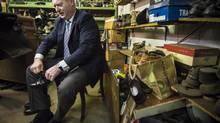 B.C. Finance Minister Mike de Jong tries on his resoled shoes from the Olde Towne Shoe Repair in Victoria on Feb. 15, 2016, the day before he delivers the budget. (JOHN LEHMANN/THE GLOBE AND MAIL)