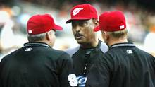 Toronto Blue Jays manager Cito Gaston confers with the umpires about having the lights turned on during the fifth inning of their game against the Baltimore Orioles in Baltimore, Maryland, on Monday. (JOE GIZA)