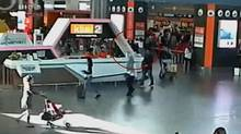 A still image from a CCTV footage appears to show (circled in red) a man purported to be Kim Jong-nam being accosted by a woman in a white shirt at Kuala Lumpur International Airport in Malaysia on Feb. 13, 2017. (REUTERS TV/REUTERS)