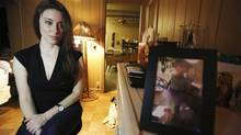 In this Feb. 13, 2017 photo, Casey Anthony poses for a portrait next to a photo of her daughter, Caylee, in her West Palm Beach, Fla., bedroom. (Josh Repogle/AP)