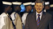 Prime Minister Stephen Harper arrives in Port-of-Spain, ahead of the Commonwealth Heads of Government Meeting, on November 26, 2009.