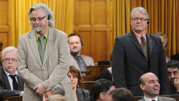NDP MPs John Rafferty and Bruce Hyer vote in favour of Bill C-19, a bill to scrap the long-gun registry, on Feb. 15, 2012. Both men lost their positions as NDP critics and were barred from making members' statements in the House.