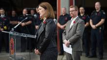 Federal Health Minister Jane Philpott, left, speaks as British Columbia Health Minister Terry Lake listens during a news conference before meeting with first responders at a fire hall in the Downtown Eastside of Vancouver, B.C., on Thursday November 10, 2016. (DARRYL DYCK For The Globe and Mail)