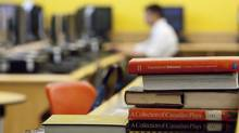 A student at Assumption College Catholic High School in Windsor, Ont., works in the school's library. As many as a dozen Catholic school boards, including those in Windsor and London, have filed for conciliation this summer, rejecting a tentative deal between the province and the English Catholic teachers' union. (GEOFF ROBINS for The Globe and Mail)
