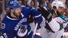 San Jose Sharks' Niclas Wallin, right, of Sweden, checks Vancouver Canucks' Ryan Kesler during the first period. THE CANADIAN PRESS/Darryl Dyck (DARRYL DYCK)
