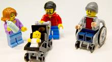 Lego unveiled its newest minifigure at the New York Toy Fair last week: a stay-at-home dad. (DANIEL KARMANN/AFP/Getty Images)